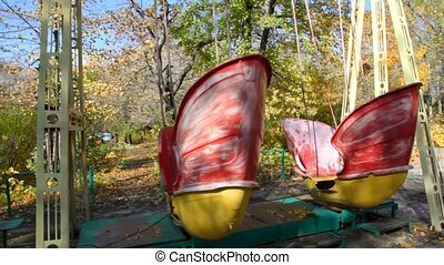 swings on playground in park - two teetering swings on...