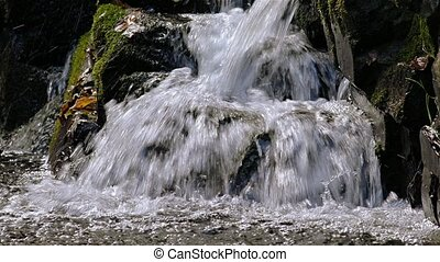Waterfall nature detail - Small waterfall with swift water