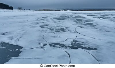 ice blue on the river water frozen winter landscape - ice...