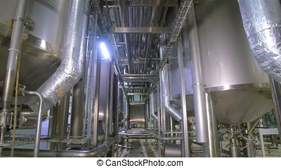 Modern technological industrial equipment. Pipelines, pumps, filters, gauges, sensors, motors. tank at chemical industrial factory.