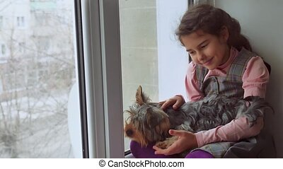 girl teen and dog sitting on a pet window sill windowsill -...