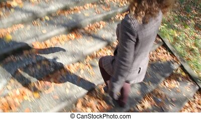 woman walking up on ladder steps - young woman walking up on...