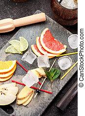 Coconut with ice and fresh fruits (grapefruit, kiwi, orange...