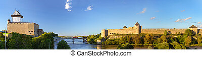 Narva Herman castle and Ivangorod fortress stand on banks of...