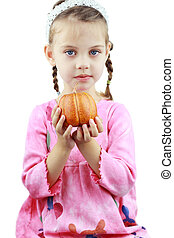 Child Holding Pumpkin - Beautiful little girl holds a...