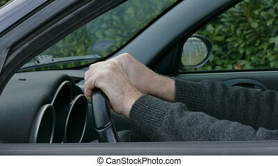 Nervous driver tapping and gesture - Nervous driver, closeup...