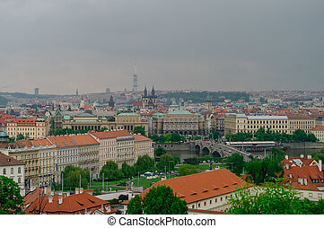 Panorama of old town roofs, Vltava river and bridge from above, Prague, Czech Republic