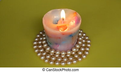 Close-up of candle burning, smoldering and extinct. Color...