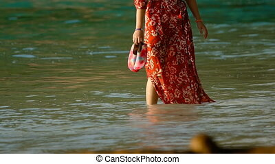 Woman walk on the beach - Woman walk on the coral sand...