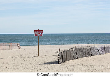 Beach Closed Sign at Point Pleasant - A sign warns people...