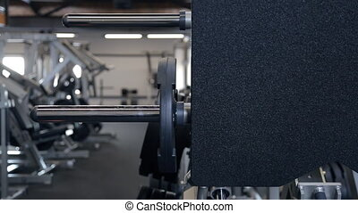 leg press machine preparation of young slim woman for training in gym