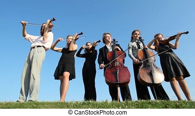 six musicians plays music on stringed instruments on upland,...
