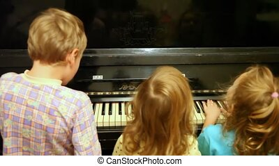 children play together on piano - children, boy and two...