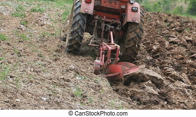 Plowing Soil with Tractor - Cultivating Soil with Tractor in...
