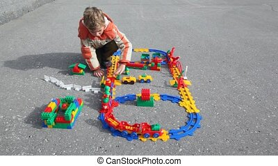 boy plays plastic railway - little boy plays plastic railway...