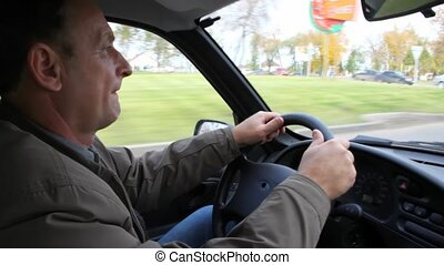 driver driving car and instrument panel - close up driver...