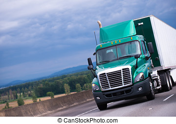 Green semi truck with container trailer on highway - Modern...