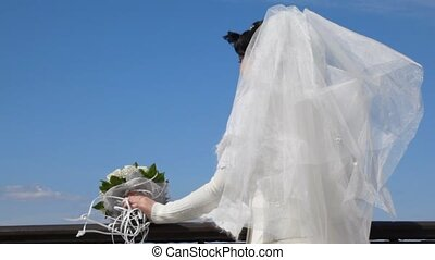 bride on observation deck against sky - bride with bouquet...