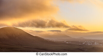 sunrise in Femes with extinguished volcanoes - scenic...