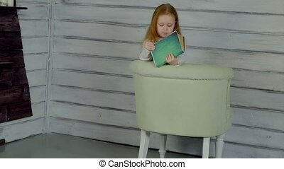 Little cute girl reading book