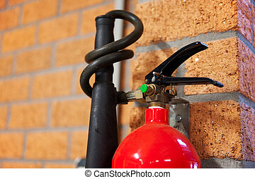 fire extinguisher - Detail of red fire extinguisher hanging...