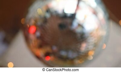 defocused rotating mirror disco ball