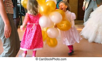 runs on dancing area with people during wedding reception -...