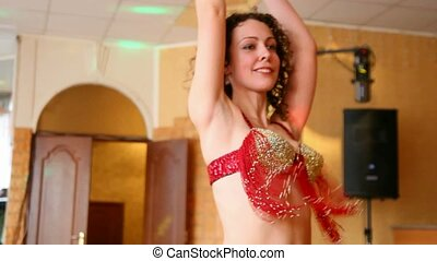 belly dancing woman indoor - belly dancing young woman...