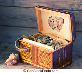 Treasure chest, old coins and treasure map