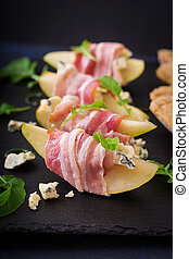 Appetizer with pear, blue cheese, prosciutto ham and toast...