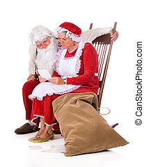 North Pole Mail - Mr. and Mrs. Santa Claus reading the kids'...