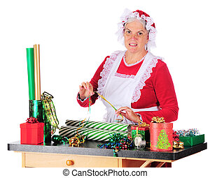 Mrs Claus Wrapping - Mrs Santa Claus wrapping Christmas...