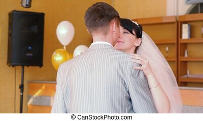 bride and bridegroom slow dancing indoor