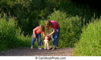 brother and sister holds doll and runs in park - brother and...