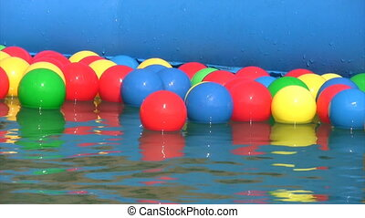 balls floating in inflatable water pool - multicolored balls...