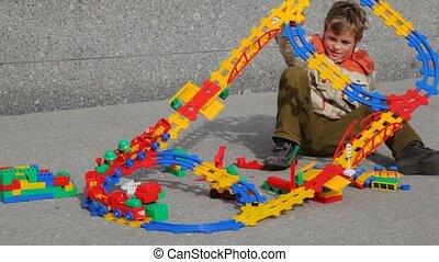 boy dresses on head toy railway