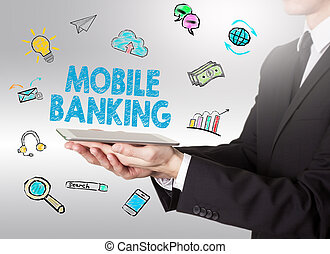 Mobile banking concept, young man holding a tablet computer.