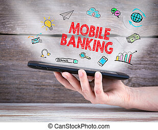 Mobile banking. Tablet computer in the hand. Old wooden...