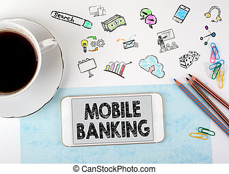 Mobile banking. Mobile phone and coffee cup on a white office desk