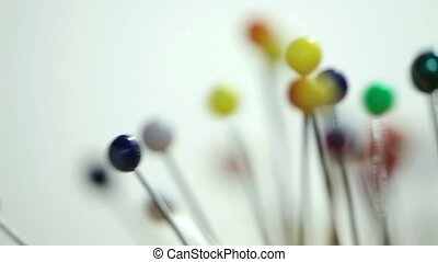 colored balls on pins rotation abstract background