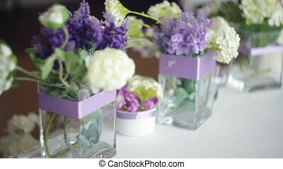 tableware and decor of bouquets of flowers for the wedding party