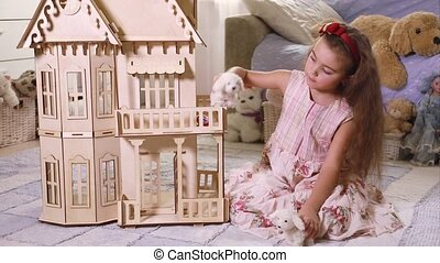 Little girl playing indoors - Pretty clever girl play with...