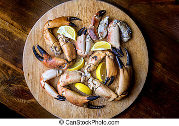 claws - crab claws on wood platw