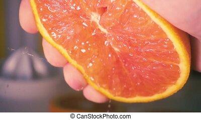Super slow motion push grapefruit juice - Super slow motion...
