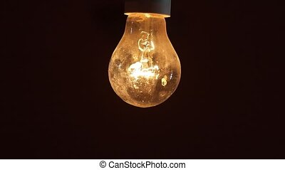 Flickering light bulb - Tungsten lightbulb flickering with...