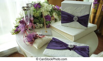 table with wedding attributes and a bouquet of flowers for...