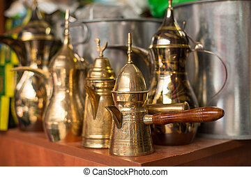 Traditional arabic coffee pots on a shelves of arabic market...