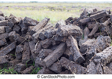 sods of turf stacked up to dry - turf stacked up for the bog...