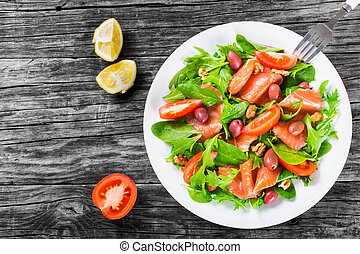 Red fish healty salad on white dish