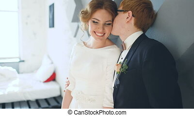 Married couple kissing and smiles each other before wedding ceremony